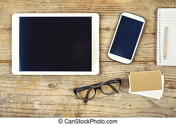 Desktop mix on a wooden office table. - Desktop mix on a...