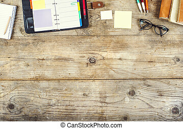 Desktop mix on a wooden office table. - Mix of office...