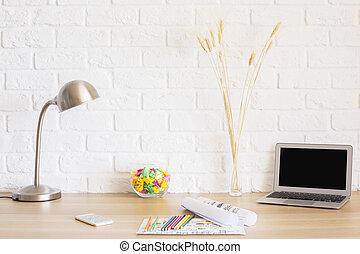 Desktop on brick wall background
