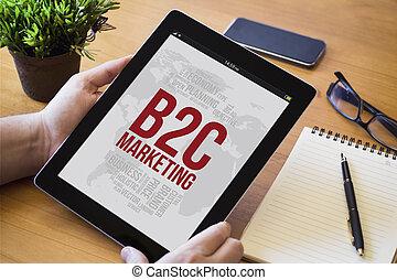 desktop tablet b2c - hands of a man holding a b2c concept ...