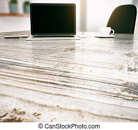 Desktop with blank laptop