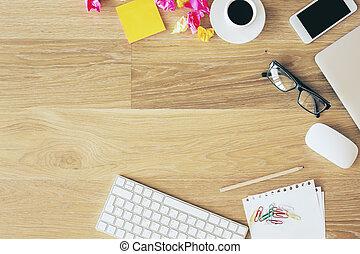 Desktop with office items - Topview of wooden office desktop...