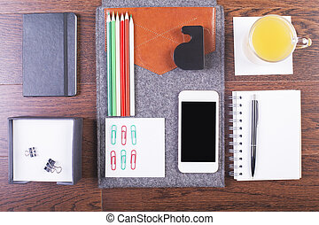 Desktop with organized tools - Top view of wooden desktop...