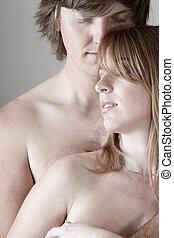 desnudo, pareja joven