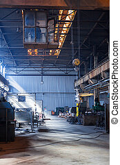 Desolate crane in an old valve factory hall - Desolate crane...