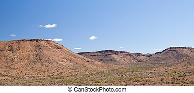 Desolate Panoramic Landscape of the arid Karoo with a bright blue sky