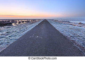 Desolate road in a winter rural landscape