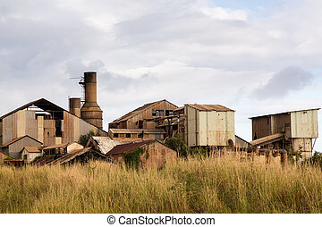 Close view of old deserted sugar mill being overgrown by nature near Koloa, Kauai in Hawaii