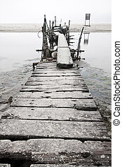 Desolated wooden pier in low saturation
