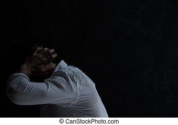 Despair man in dark room