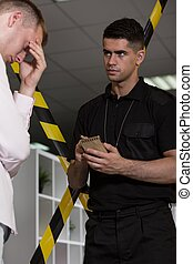 Despair man talking with policeman