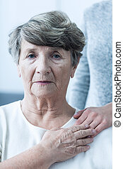 Despair senior woman
