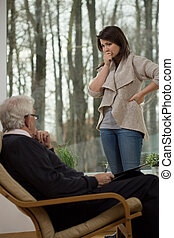 Despair woman talking with therapist