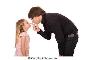 Despairing father pointing finger at his daughter