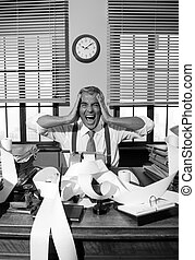 Desperate accountant shouting head in hands in vintage 1950s style office.