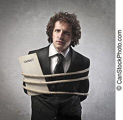businessman tied - desperate businessman tied with rope