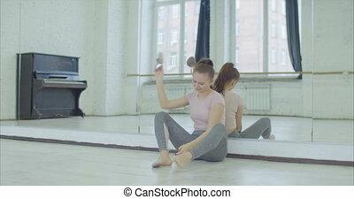 Desperate female dancer throwing away ballet shoes -...