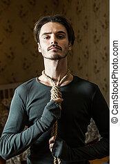 Desperate man hold a noose around his neck. - Desperate man...