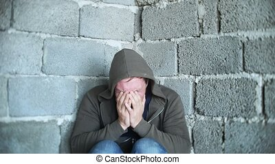 desperate unhappy man by the wall, the concept of stress and hopeless