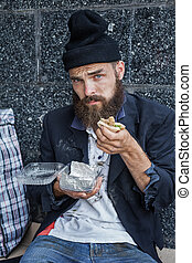 Desperate vagrant - Sad homeless is having his meal