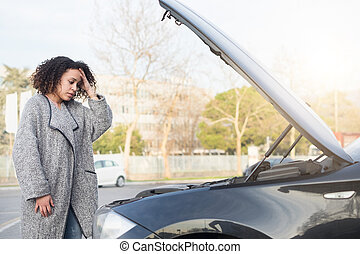 Desperate woman after checking car broken engine