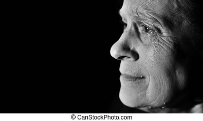 Desperate woman crying - Aged woman crying at dark room