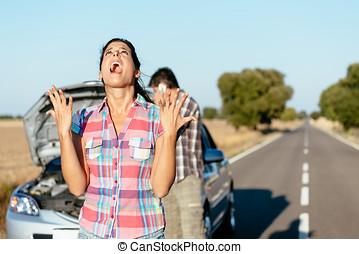 Desperate woman suffering car breakdown