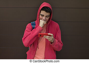 desperate young man with mobile phone