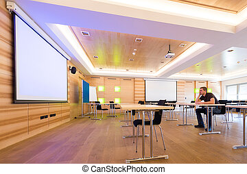 desperated man in conference room with white projection...