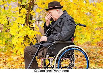 Despondent despairing senior amputee
