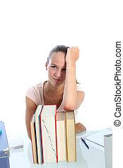 Despondent scholar with her textbooks