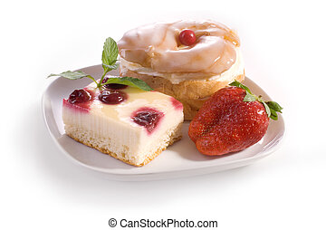 A dessert garnished with fresh strawberries at a sidewalk cafe