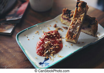 Dessert Blueberry cheese cake with strawberry jam on wood table background