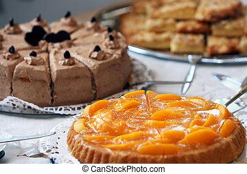 Dessert buffet at a wedding reception with an assortment of...
