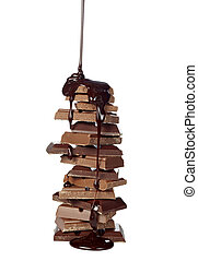chocolate syrup leaking on stack of chocolate blocks on white background with clipping path