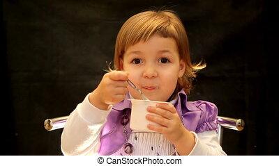 dessert cheese - girl eating a dessert cheese