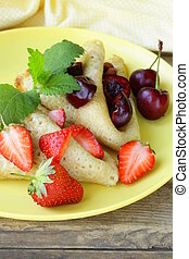 dessert crepes with berries cherrie
