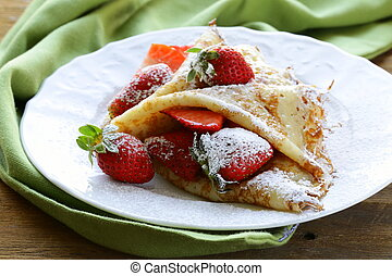 dessert crepes with strawberries