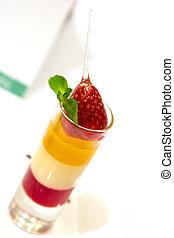 Delicious fruit dessert garnished with mint leaf