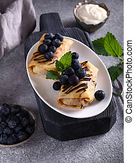 dessert pancakes stuffed with berries