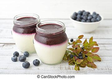 Dessert panna cotta with fresh blueberry on wooden ...