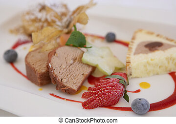 Dessert with Strawberrys and Blueberrys on a white Plate -...