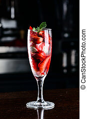 Dessert. Strawberries with ice-cream in the glass on the table,