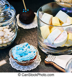 Dessert Sweet cupcakes and marshmallow in Candy Bar On...