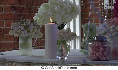 Dessert table decorated with white flowers