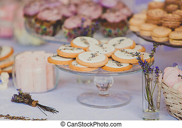 Dessert table for a wedding party. Biscuits decorated with lavanda flowers