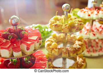 Dessert table for party. akes and sweetness. Shallow dof