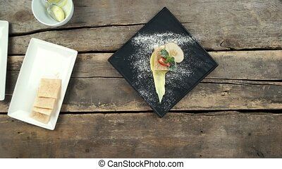 Dessert with powdered sugar. Napoleon cake top view.