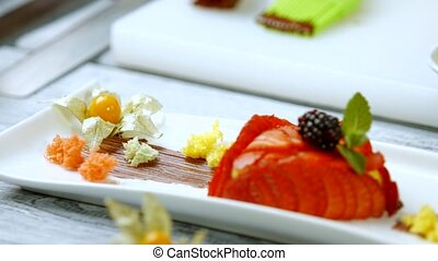 Dessert with strawberry and blackberry. Pieces of bread with...