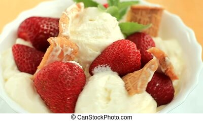 Dessert with strawberry ice cream and waffles